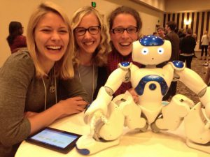 Attending and presenting at International Symposium for Pediatric Pain 2015 in Seattle. Photo: Lauren Heathcote, Katelynn Boerner & Line Caes posting with MEDI, a robot to distract children during painful medical procedures.